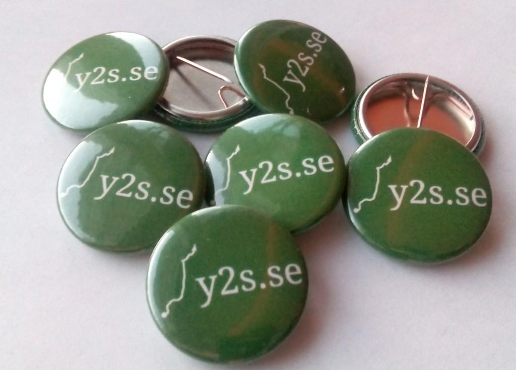 Badges med logotypen på